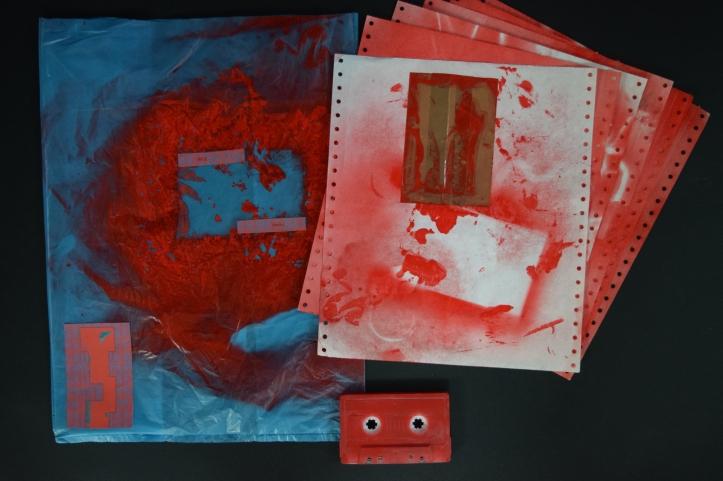 07 karl & rene - mai 12 asaotpu cassette (cassette, plastic bag, paper, spray paint)